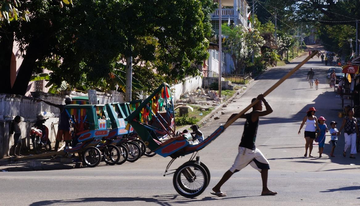 pouss-pouss driver at cross street