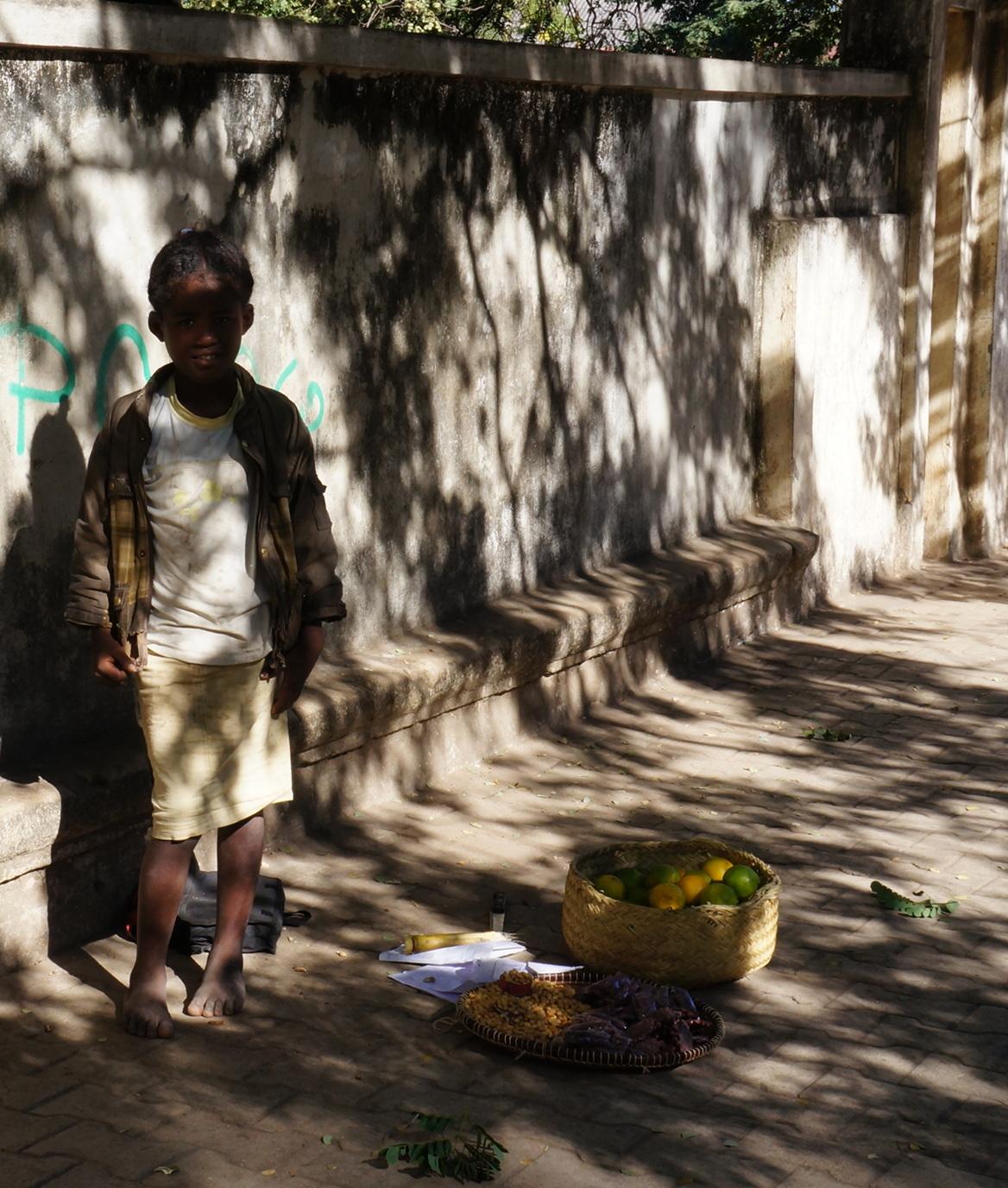 Madagascar - girl selling mandarins