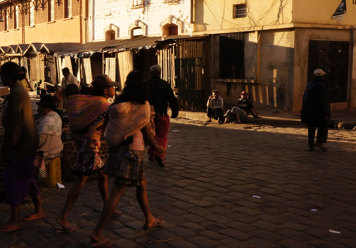 Antananarivo - two girls striding with papooses