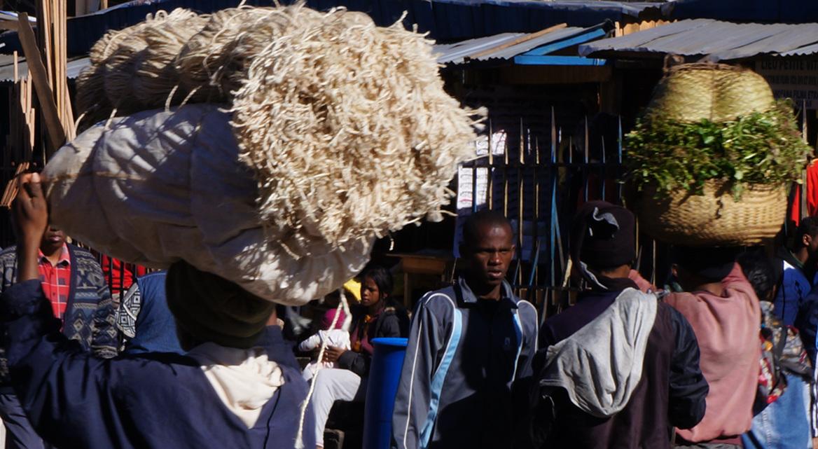 Carrying baskets on heads - morning market- Madagascar - Antananarivo