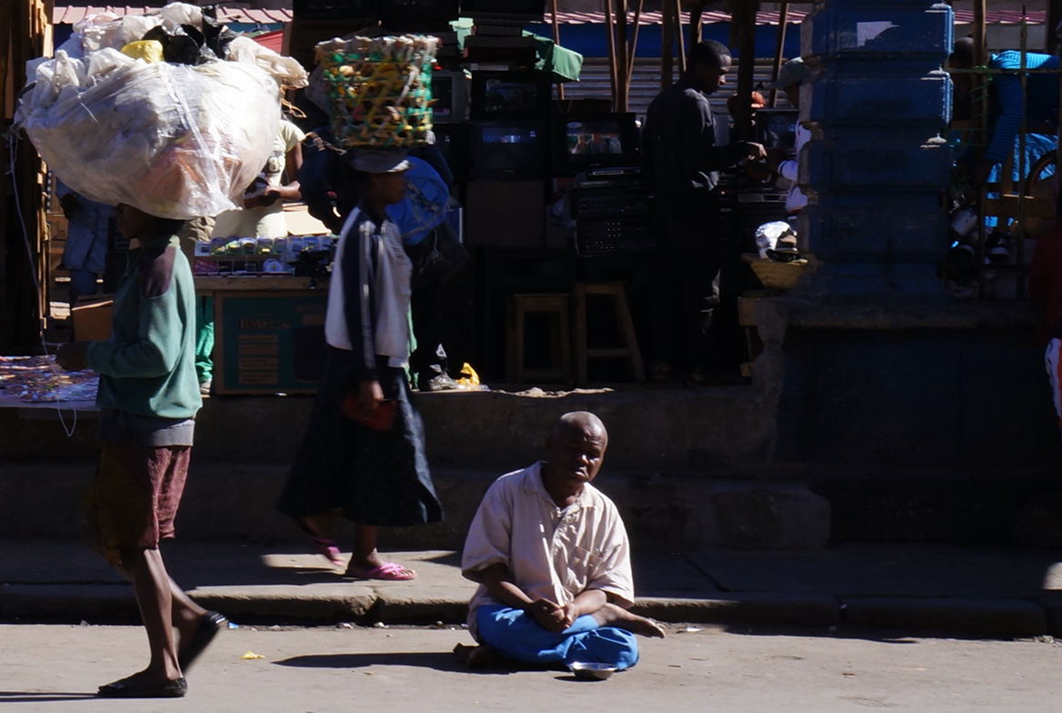 Beggar sitting on ground - Madagascar - Antananarivo