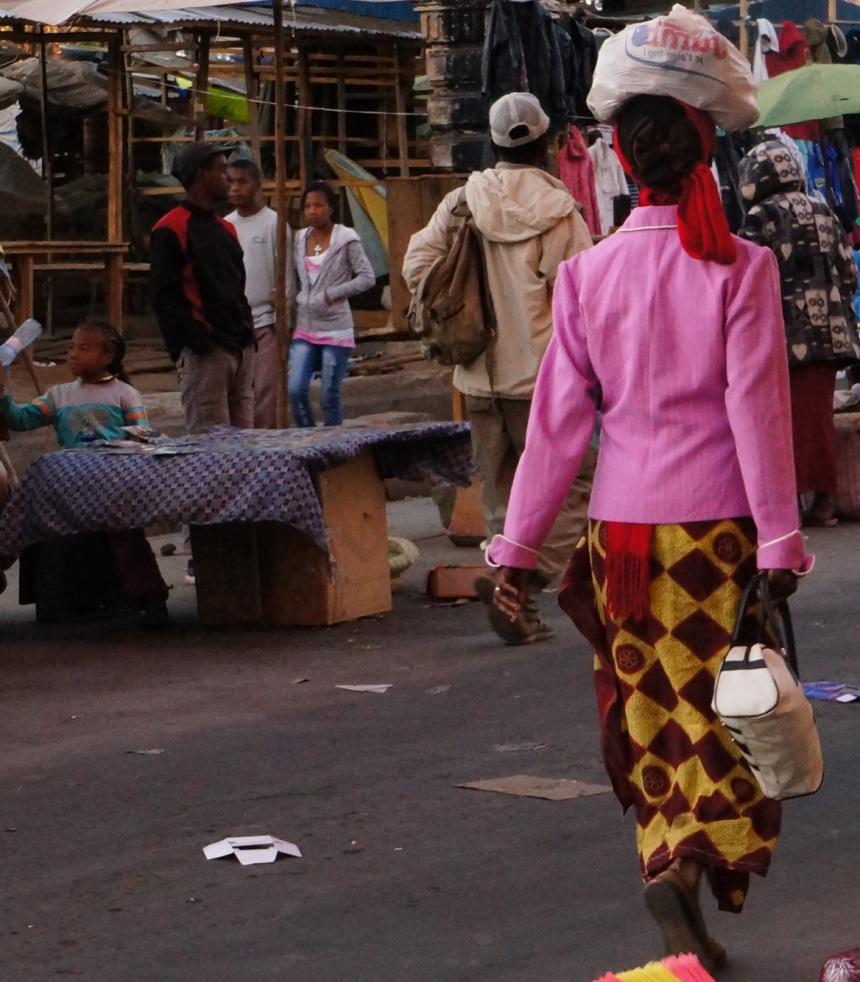 Madagascar woman with bag on head