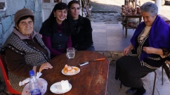Eating hand-made cheese with Armenian old lady at Goshavank