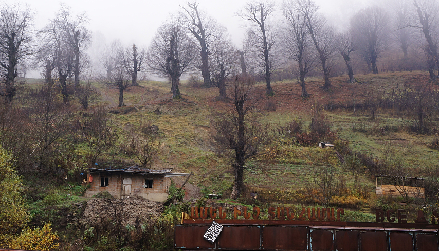 Armenia - Hill with house and old metal building