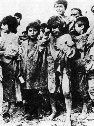 Armenian children outside orphanage gates