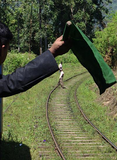 Train to Nuwara Eliya - Conductor with Flag