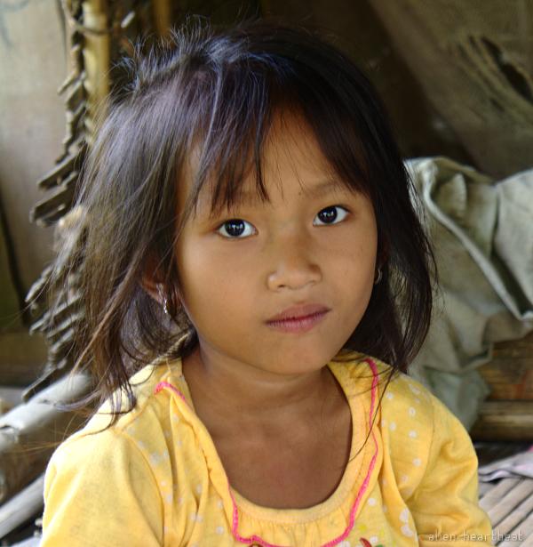 Laos-Khmu_village-girl_in_yellow_top-beautiful_face