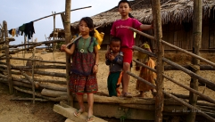 Laos-Hmong_village-girl_fetching_water