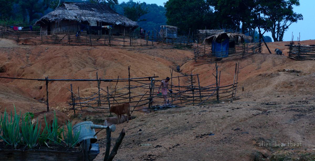 Laos-Hmong_village-taking_an_evening_shower